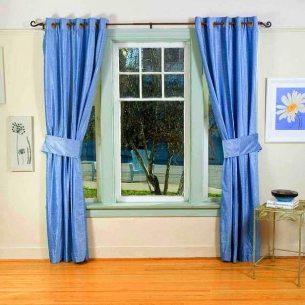 Голубые шторы в интерьере: фото, идеи и примеры